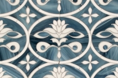 Beatrice, a waterjet jewel glass mosaic, shown in Marcasite and Absolute White, was designed by Caroline Beaupère for New Ravenna.