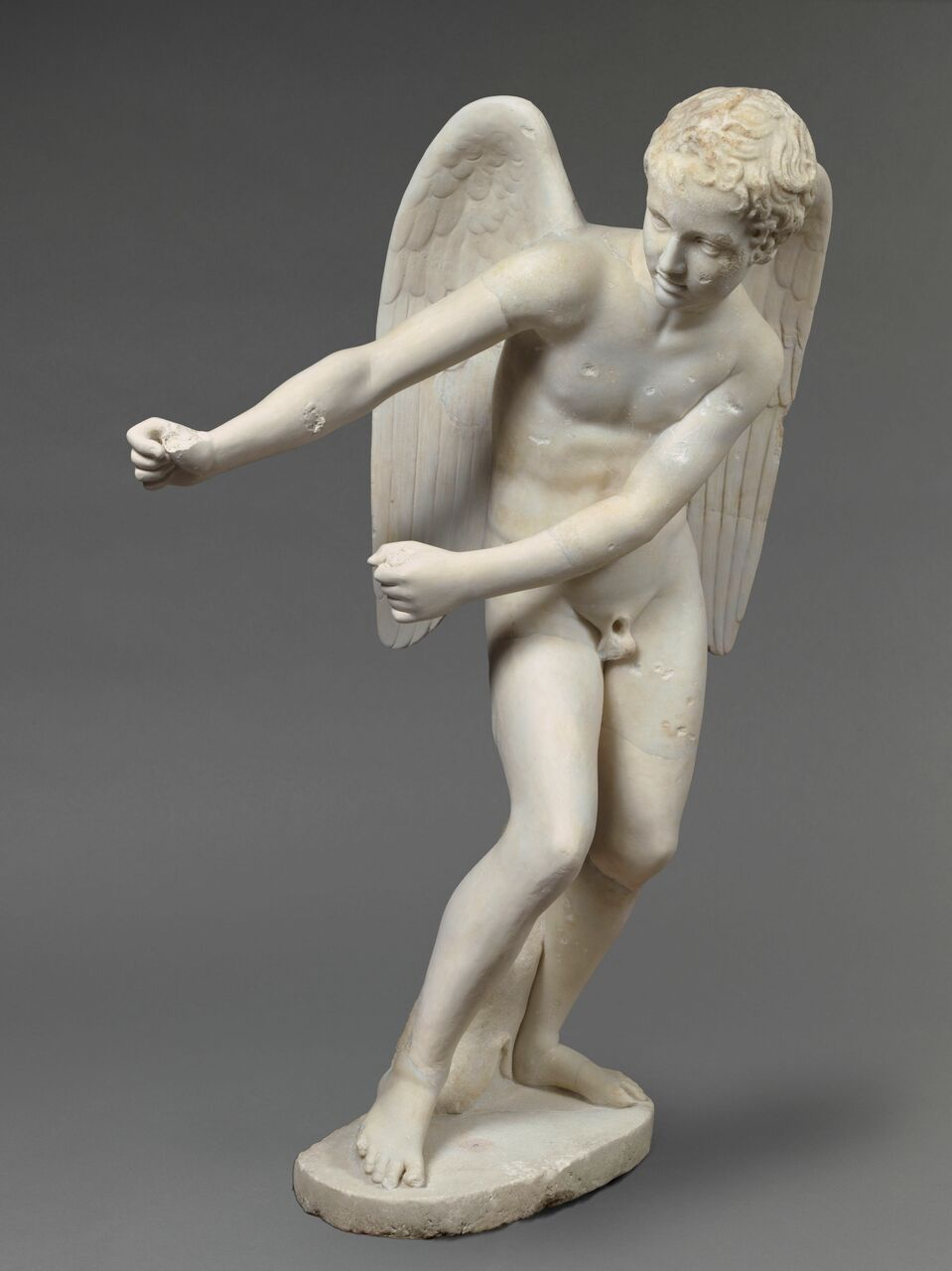 Eros Stringing his Bow- 2nd century AD, Marble, Louvre Museum, MA 448 (MR 139) © RMN–Grand Palais / Art Resource, NY