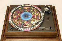 Fatimah Tuggar, Fai-Fain Gramophone, 2010 Record player, raffia disks with labels, music by Barmani Choge, entertainment center 53 x 32 1/2 x 24 in. (134.6 x 82.5 x 70 cm) Artwork Credit: Courtesy of Fatimah Tuggar and BintaZarah Studios