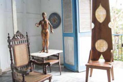 In Nelson Domínguez's historic Old Havana studio, Victorian pieces are in dialogue with his clothespin-backed throne—behind is a balcony overlooking the extensive rear garden.