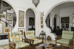 A series of dynamic arches define the spaces of this 1930s living room in Miramar, which is a traditional Mediterranean-style house on the outside.
