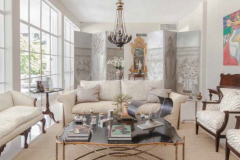 The living room's stylish mix includes antique English furniture, a Spanish Colonial bench, a 1961 Pop art painting by Umberto Peña and a Lolo Soldevilla sculpture on the cocktail table.