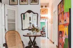 In the front hall, a bentwood rocking chair and console table bear witness to the many European imports that have been staples of Havana's eclectic interiors.