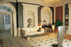 The hall at Britwell, with the bowler hats my father wore riding. A top hat would have been worn for hunting. In the corner is a banana tree in a basket, an expensive experiment in the English countryside.