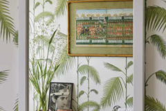 f ever we feel homesick for the tropics, we stand in this bathroom and breathe in the view of the palm fronds. The bookstand trolley was from Kensington Place and has KP carved on the underside to prove it. My mother's grandmother (the granddaughter of Queen Victoria) had apartments there when she was widowed. Spot the photograph of Prince Charles at his Investiture, aged twenty; this is when he became the Prince of Wales.