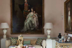 A George Romney painting—the one that made his career, in fact. This went away on tour a few years ago, and my father brought in a photographic copy with the same dimensions. Below the painting are Chinese vases that my father transformed into table lamps.
