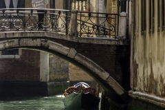 Gondolier on Bridge, Venice, Italy