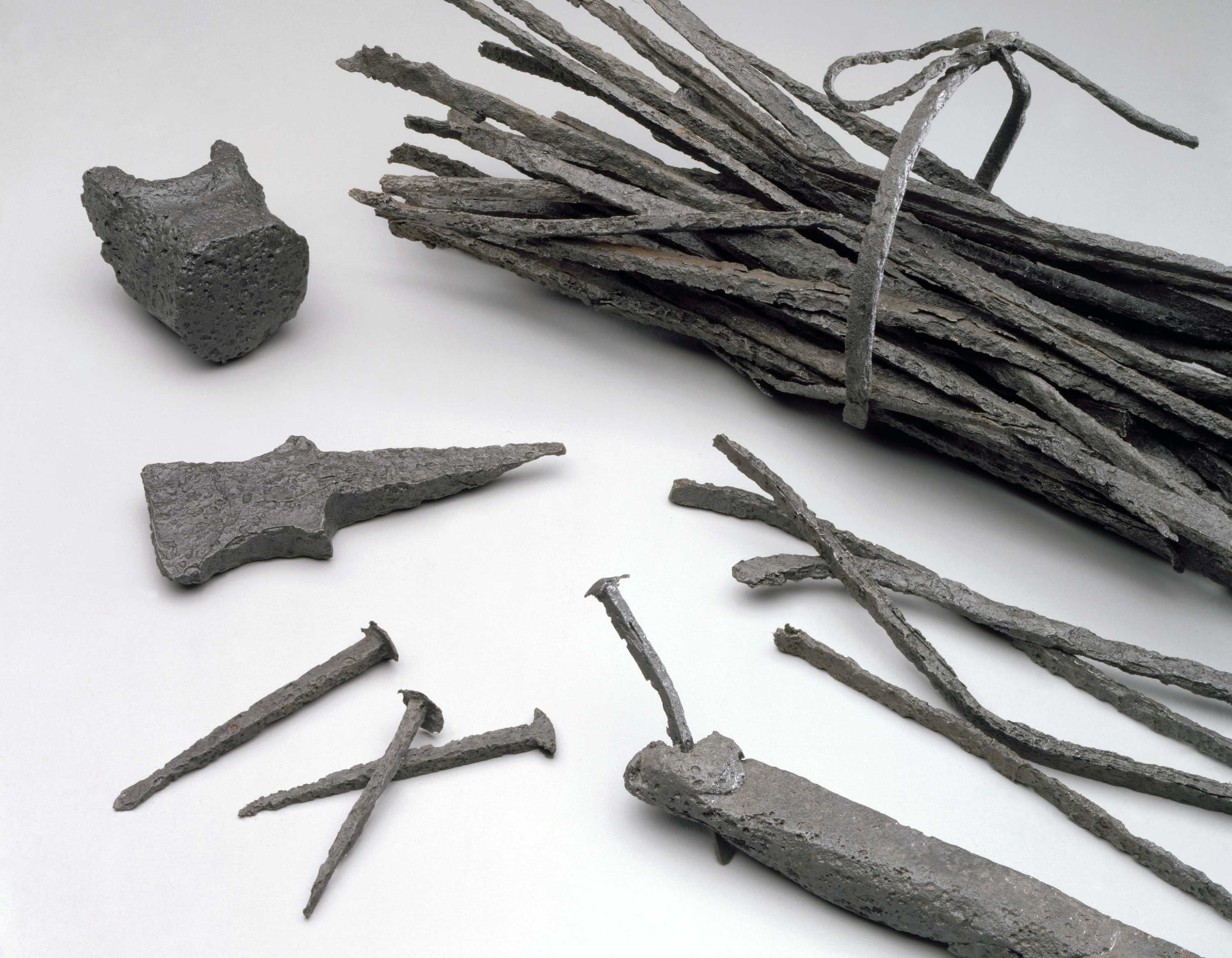 Nail-making materials excavated on Mulberry Row, Monticello, Charlottesville, Virginia, clockwise from top: nailrod, hammer head fragment, nails, hardy with nail inserted Courtesy of The Thomas Jefferson Foundation, Monticello ©Thomas Jefferson Foundation at Monticello
