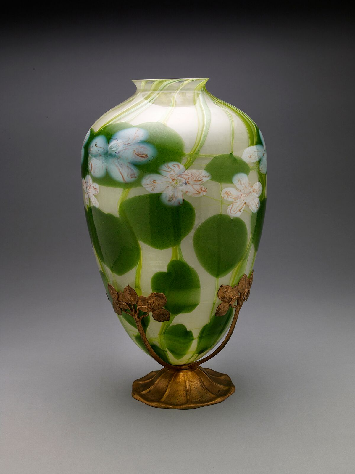 Tiffany Studios, Water Lily Millefiore Vase with Stand , about 1910, blown glass, gilt bronze stand. Photograph by John Faier. © Driehaus Museum 2013