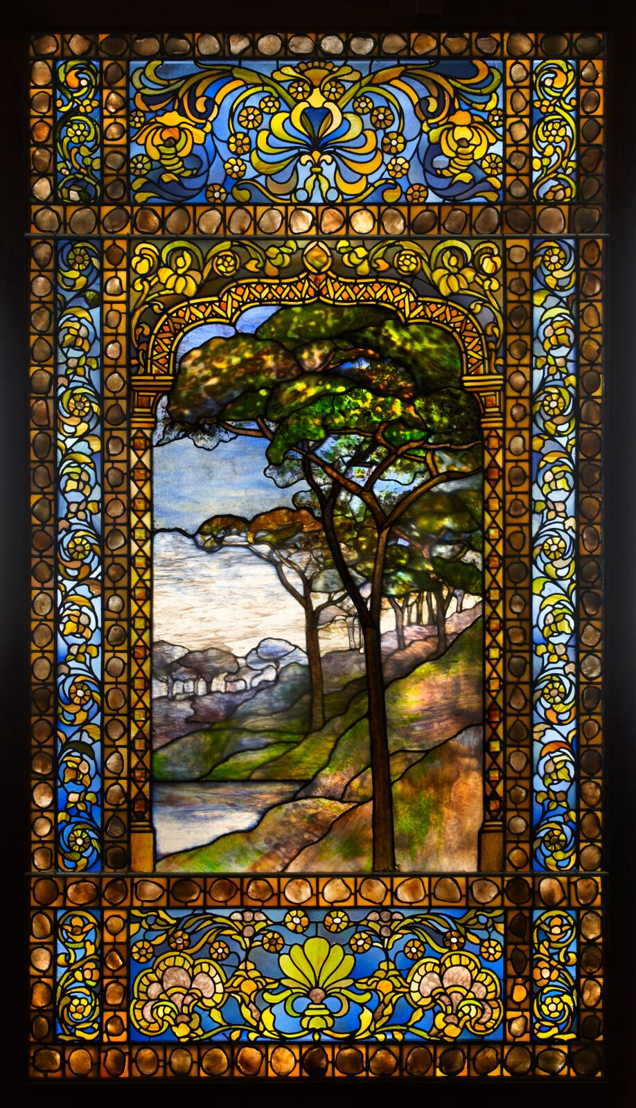 Tiffany Studios, Landscape Window , 1893–1920, leaded glass, pebbles. Photograph by John Faier. © 2013 Driehaus Museum