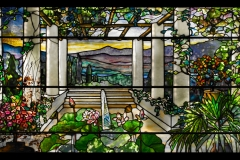 Tiffany Studios, Garden Landscape Window , 1900–1910, leaded glass. Photograph by John Faier. © 2013 Driehaus Museum