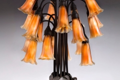 Tiffany Glass & Decorating Company, Eighteen-Light Lily Table Lamp , prior to 1902, bronze, blown glass. Photograph by John Faier. © 2013 Driehaus Museum