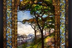 Tiffany Studios, Landscape Window , 1893–1920, leaded glass, pebbles. Photograph by John Faier. © 2013 Driehaus Museum