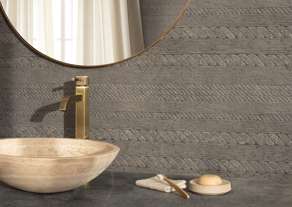 Cardigan, a waterjet and hand-cut stone mosaic, shown in tumbled Cavern.