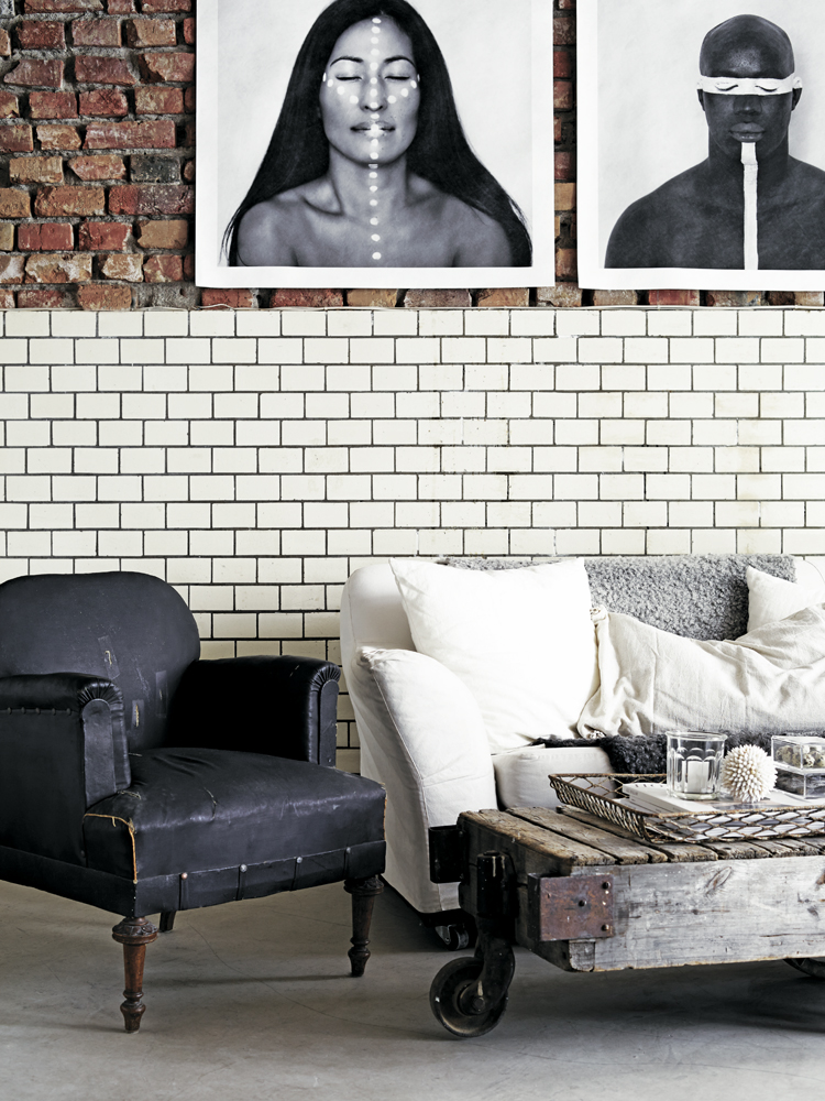 The tiled lower walls add a domestic feel to the former mechanical workshop. Photo by Kristofer Johnsson