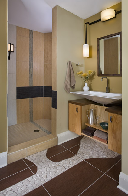 "Modern bathroom with walk-in shower and ""path"" of white tile on brown tile floor"