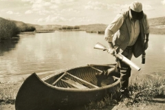 10-%ef%bf%bcernest-hemingway-stepping-out-of-a-canoe-sun-valley-idaho-october-1941-copy