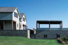 a-simple-stone-wall-forms-its-own-multifunctional-property-line