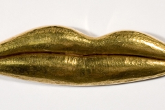 Man Ray (1890–1976); Untitled (Gold Lips), n.d.; Gold; 1 x 4 in. (2.5 x 10.1 cm); Man Ray Trust; © 2011 Man Ray Trust/Artists Rights Society (ARS), New York/ADAGP, Paris.