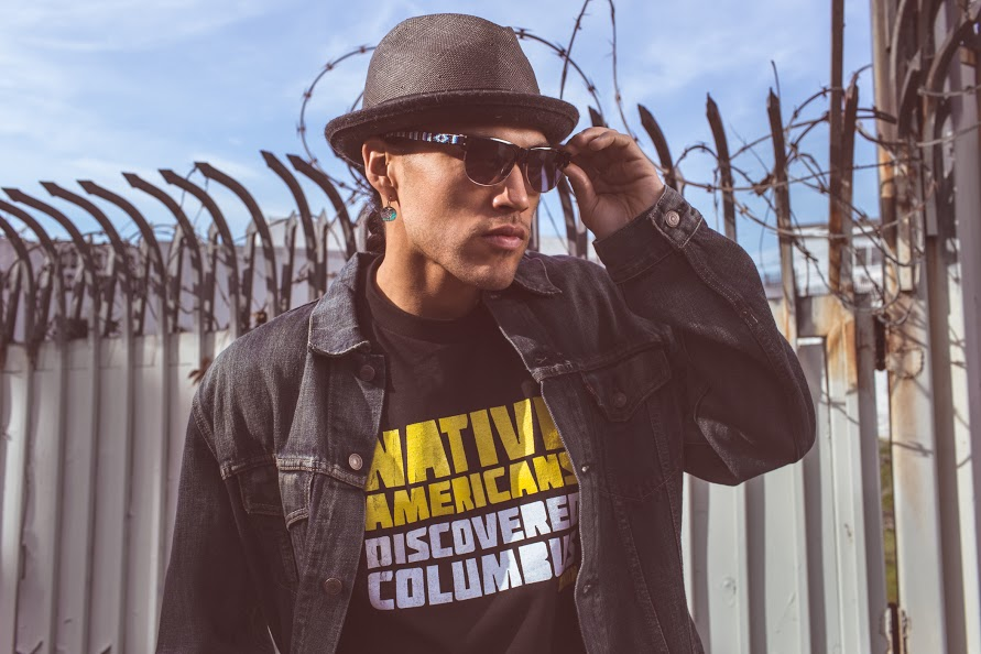 Jared Yazzie (Diné [Navajo]) for OxDx. Native Americans Discovered Columbus T-shirt, 2012. Cotton. Peabody Essex Museum, Salem, Massachusetts. Gift of Karen Kramer, 2015.11.4. Photography by Thosh Collins.