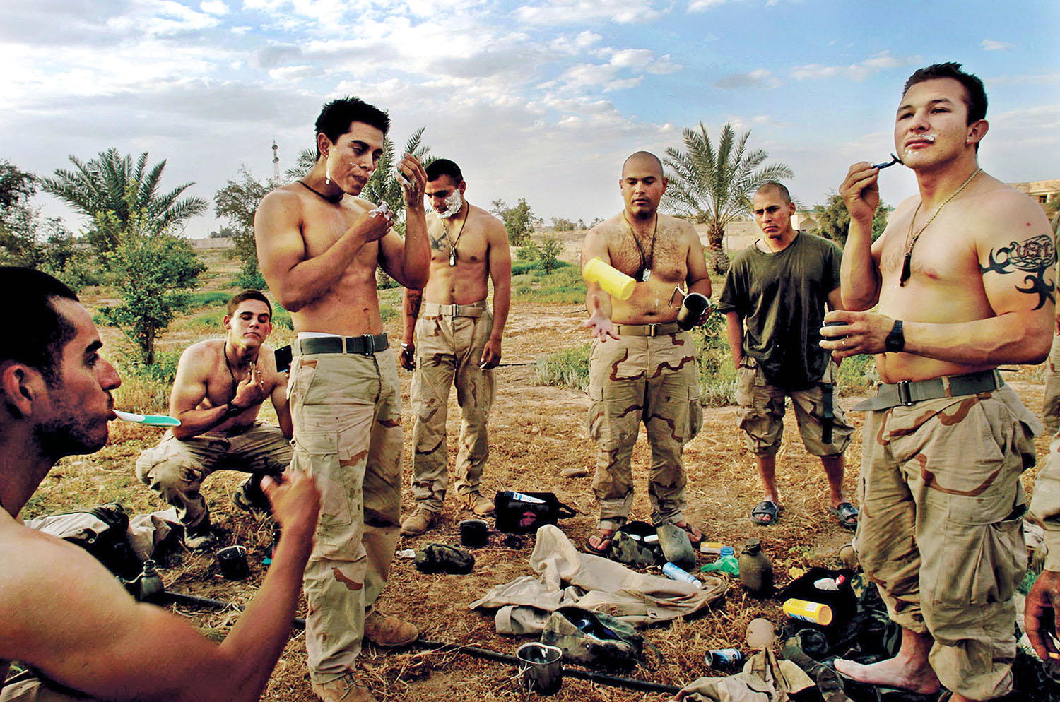 April 15, 2003 United States Marines take a break to shave in front of one of Saddam Hussain\'s presidential palaces the day Tikrit fell from Republican Guard rule in Iraq. (Credit: Lynsey Addario/ VII)